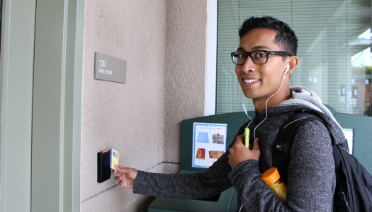 UC Merced student using CatCard for access
